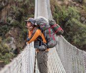 Suspension bridge on Annapurna Circuit - most popular tourists trek in Himalayan mountain massive in Nepal.