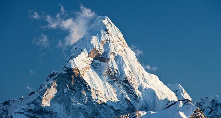 Ama Dablam is a mountain in the Himalaya range of eastern Nepal. The main peak is 6,812 metres (22,349 ft), the lower western peak is 5,563 metres (18,251 ft). Ama Dablam means